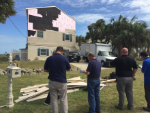 FEMA photo, officials examine damage after Hurricane Matthew.
