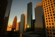 Buildings in downtown Houston reflect the light of the setting sun. Credit: Mike Blake JM/Reuters